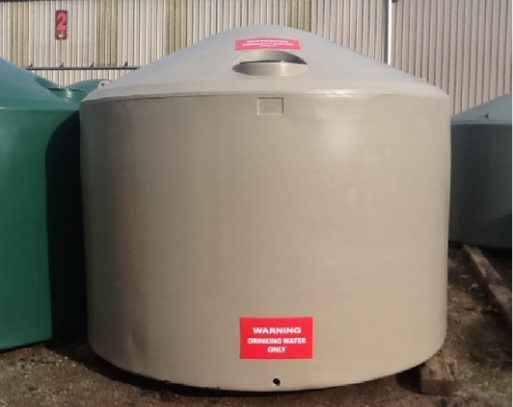 Large water tank with red warning label saying WARNING: DRINKING WATER ONLY